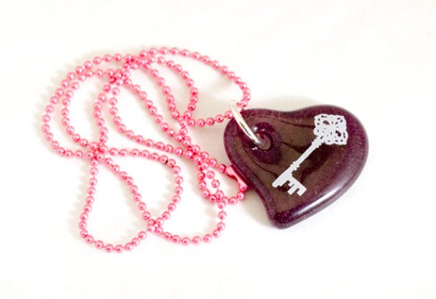 Key design in white, on red cast glass heart pendant
