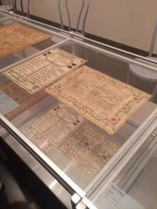 Samplers on display.  Photo: adventures in biography