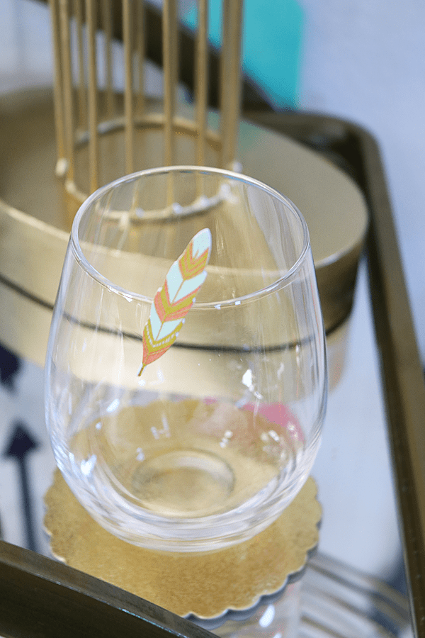 Painted Feather Clothespin on a stemless wine glass