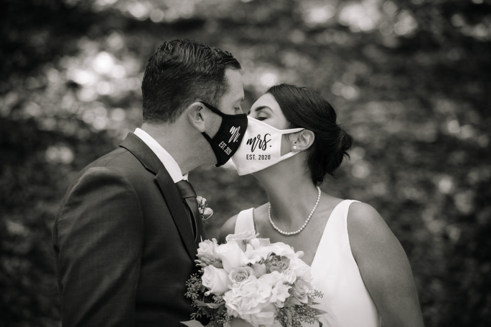 bride and groom in covid masks