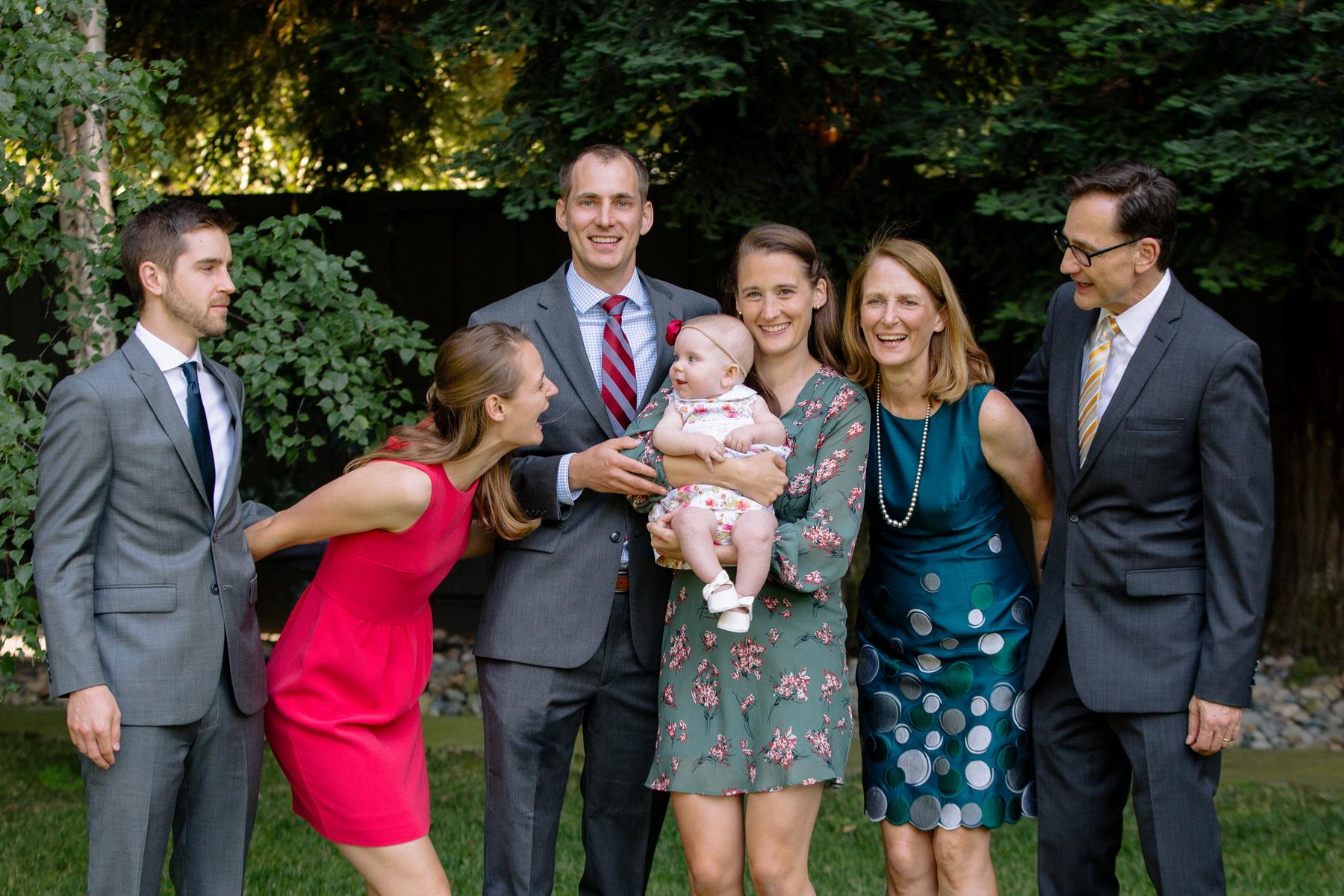 casual family portrait at a backyard wedding