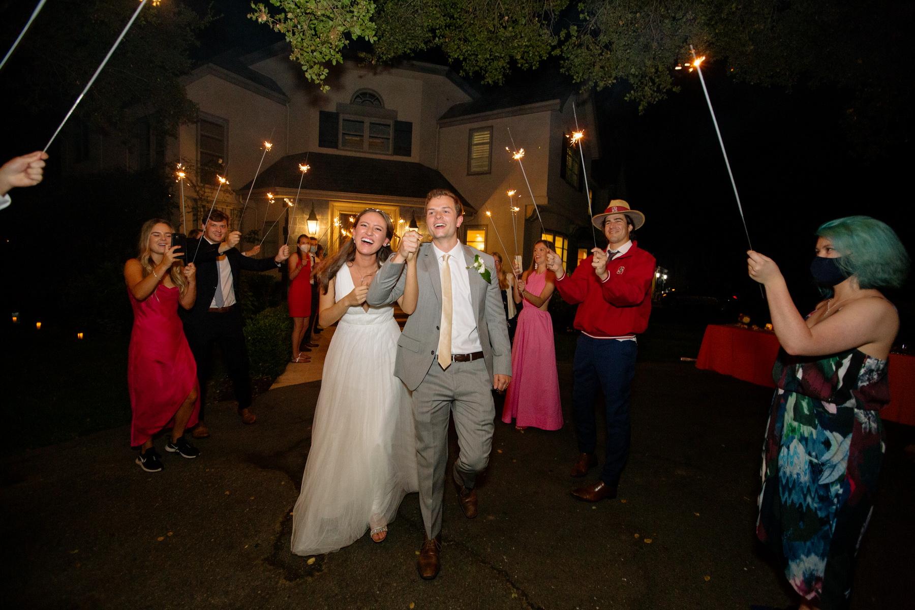 bride and groom leave wedding with sparkler sendoff