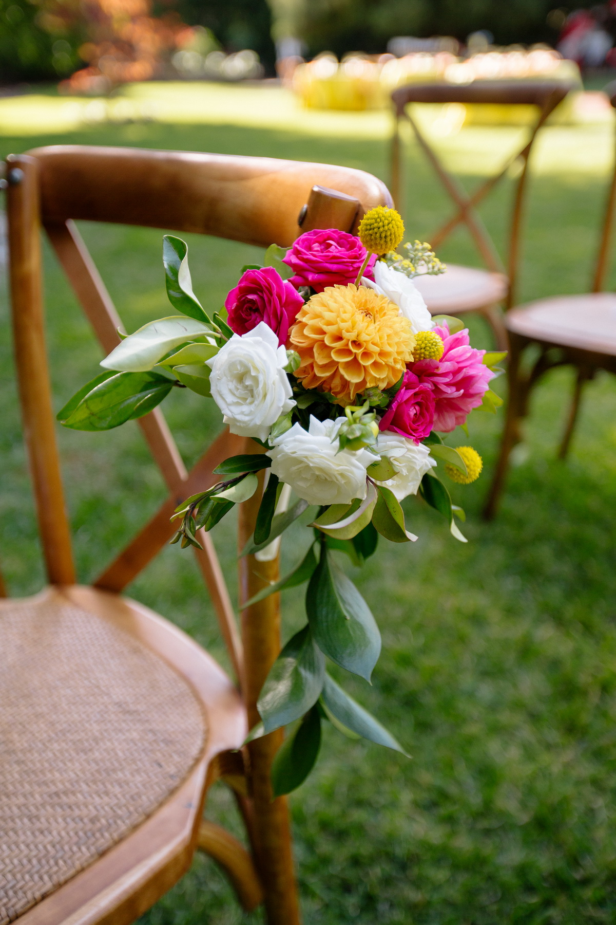 colorful wedding flowers on a ceremony chair