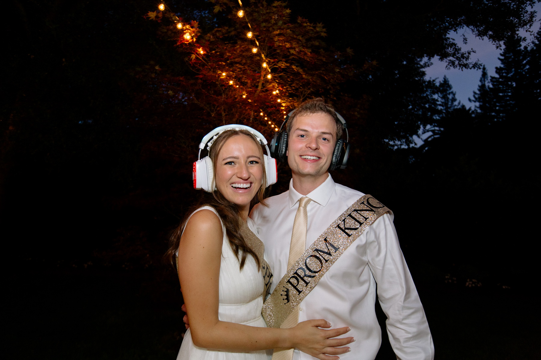 bride and groom with silent disco earphones at their backyard wedding