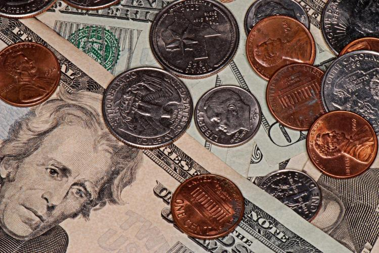 Photograph showing currency to convey saving money by filing bankruptcy.