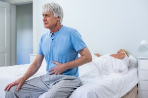 older man with hernia pain