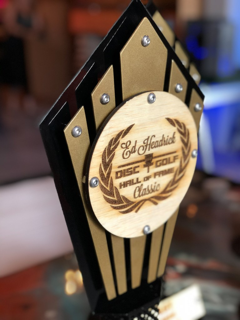 Close up on hand build trophies made for Disc Golf Hall of fame. Metal trophies made custom out of wood and metal. Each piece was hand assembled.