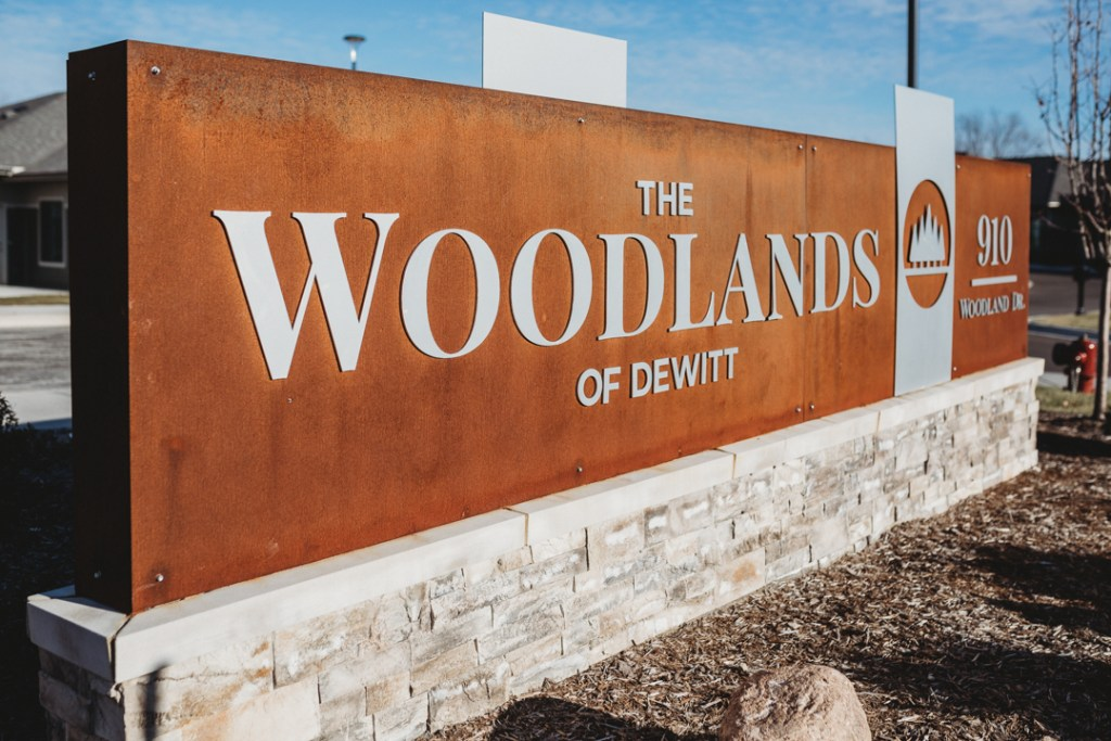Commercial Sign for The Woodlands of Dewitt. This custom sign was made from corten and stainless steel.