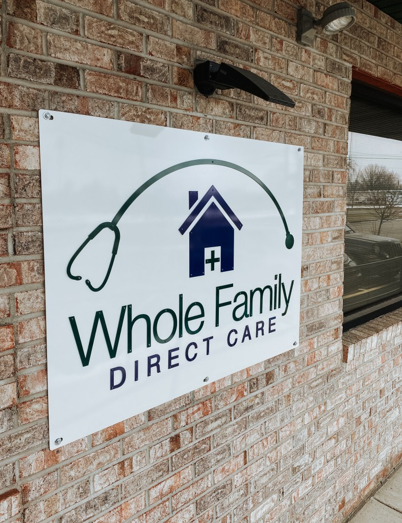 Custom logo sign just after it was installed at Whole Family Direct Care in Marshall, Michigan