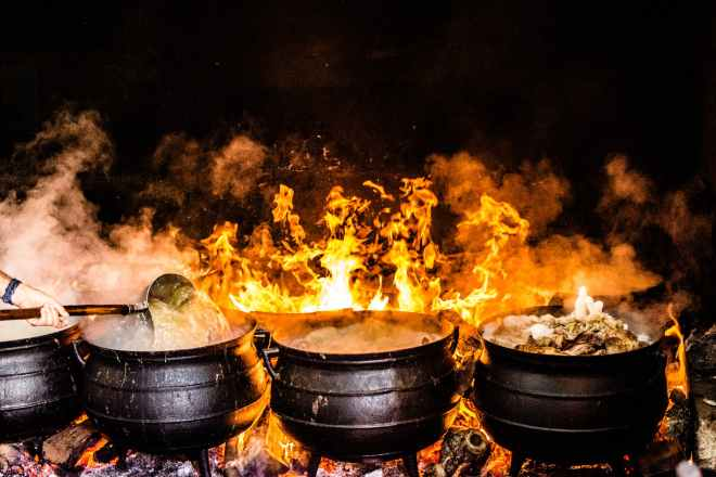 time lapse photography of four black metal cooking wares