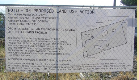 Parody land use sign at former Vitamilk site promises huge ball pit and slide