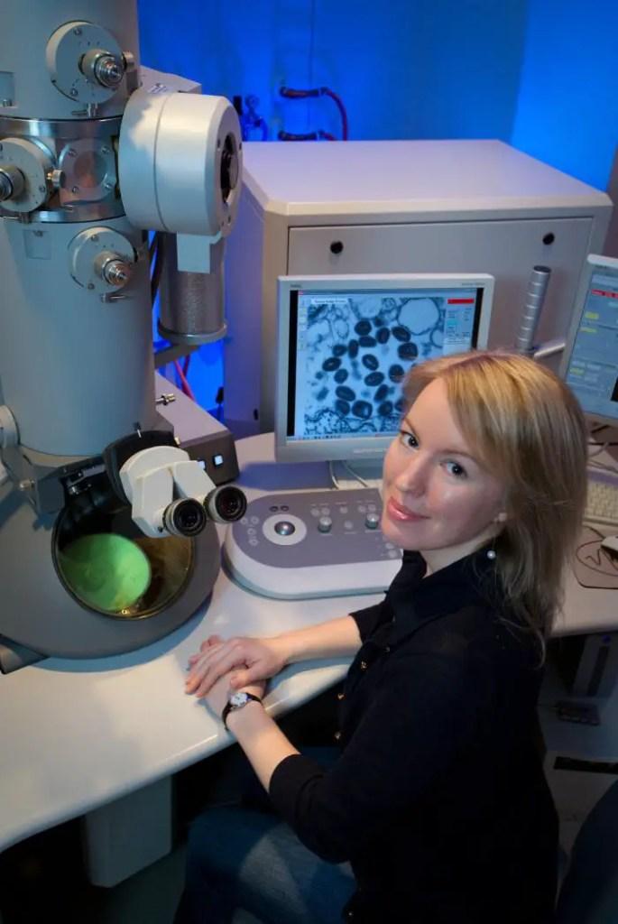 Scientist observing variola virus in TEM