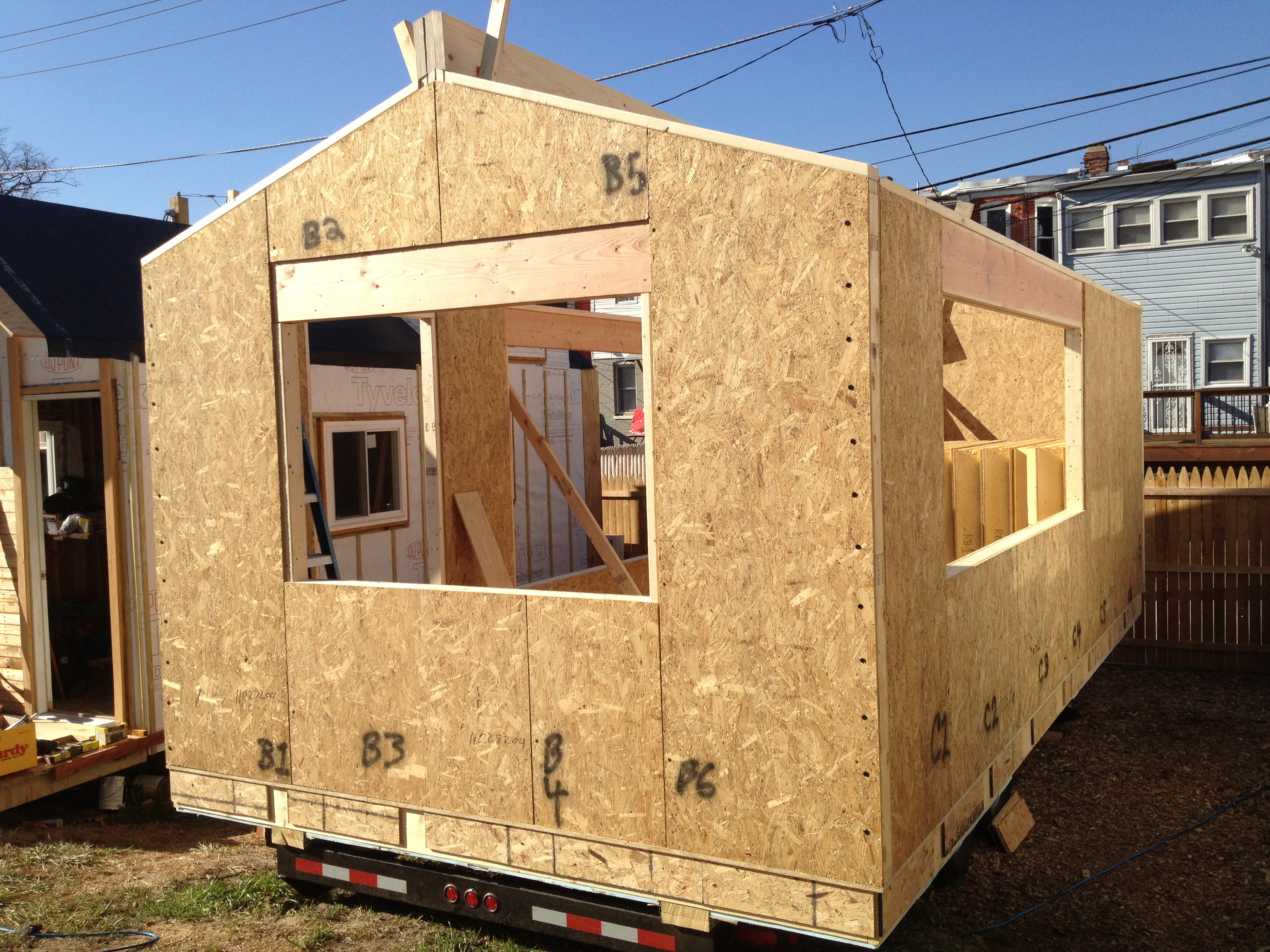 Minim house construction starts micro showcase for Sip built homes