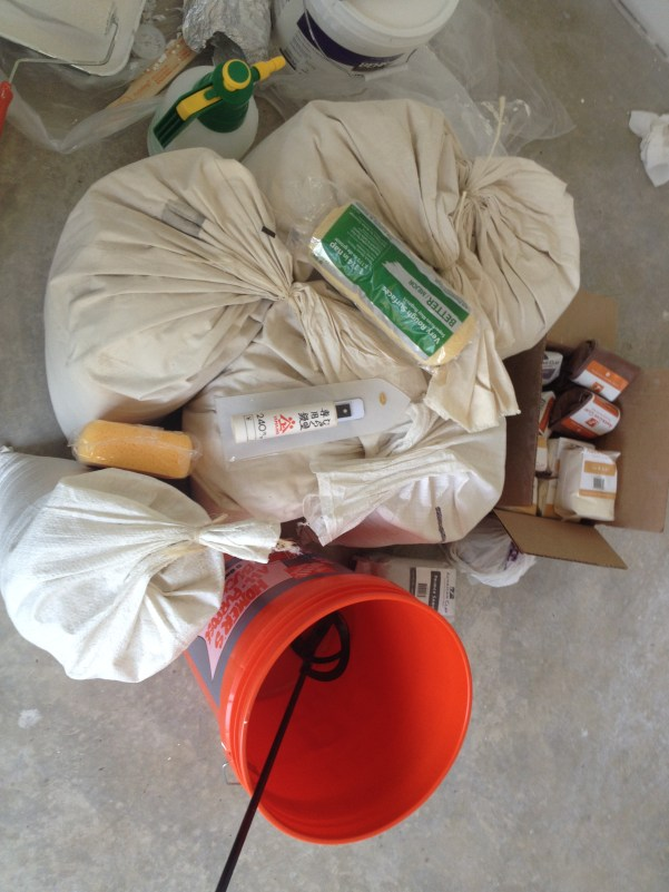 Bags of American Clay ready for mixing for wall application