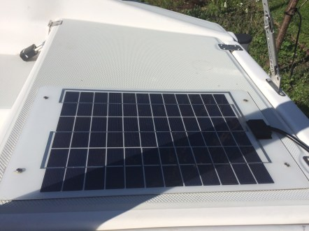 Small 15 watt solar charger powers the boat electronics, pumps and lighting