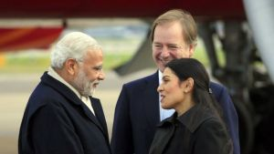 Mr Modi was greeted at Heathrow by ministers Hugo Swire and Priti Patel