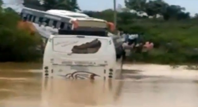 Tourist bus stuck in river