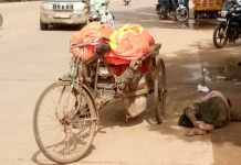 Telugu news An orphaned corps on the road .. rickshawala in the madness of alcohol