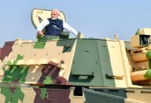 Telugu news PM Modi inaugurates L&T's K9 Vajra gun-making facility, L&T had in 2017 won the Rs 4,500-crore contract from the Ministry of Defence to supply 100 units of K9 Vajra-T 155 mm/52 calibre tracked self-propelled gun systems to the Indian Army under the Centre's 'Make in India' initiative.