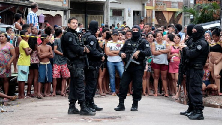'Massacre' reported at Brazil bar, media says 11 dead after 7 gunmen opened fire.