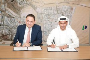 Omar Al Mesmar and Wessam Daoud sign the agreement