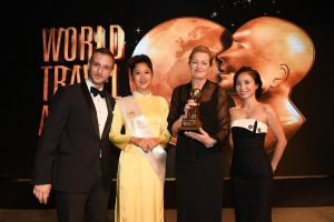 Etihad Airways' General Manager for Australia and New Zealand, Sarah Built, accepts the award for Australasia's Leading Airport Lounge from event hosts Greg Ohan (left) and Mai Anh Du (right).