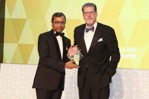 Sunil John receiving the award from Brian Lott
