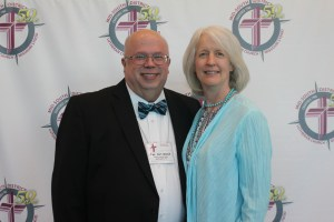 Many banquet guests, like Rev. Carl and Gwen Wenck, stopped by the 50th Anniversary photo booth.