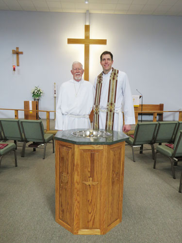 baptismal font designed and built by Mr. Mohr.