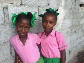 2-girls-in-pink-smiling-