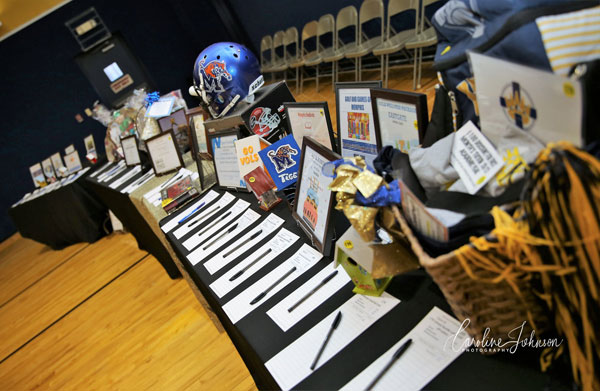 Over 100 items, including handmade items, gift cards, entertainment packages, and baskets galore, made for exciting bidding.