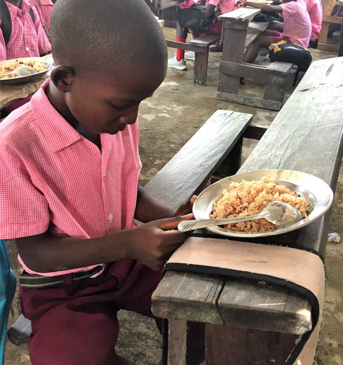 Student in the Trinity Hope feeding program