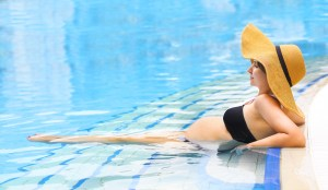 Pregnant woman sitting in a pool