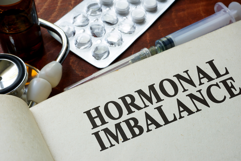 """paper with """"hormone imbalance"""" diagnosis on desk"""