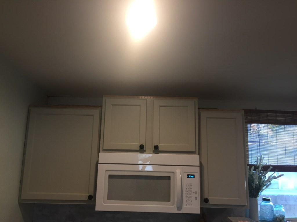 Painting Kitchen Cabinets and DIY Cabinet Molding