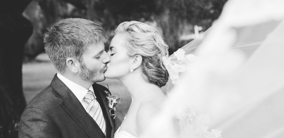 Wedding Photography in Myrtle Beach -black and white wedding photography of bride and groom kissing