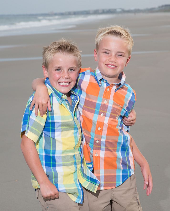 Myrtle Beach Photography - young twin brothers standing on a beach in flannel shirts