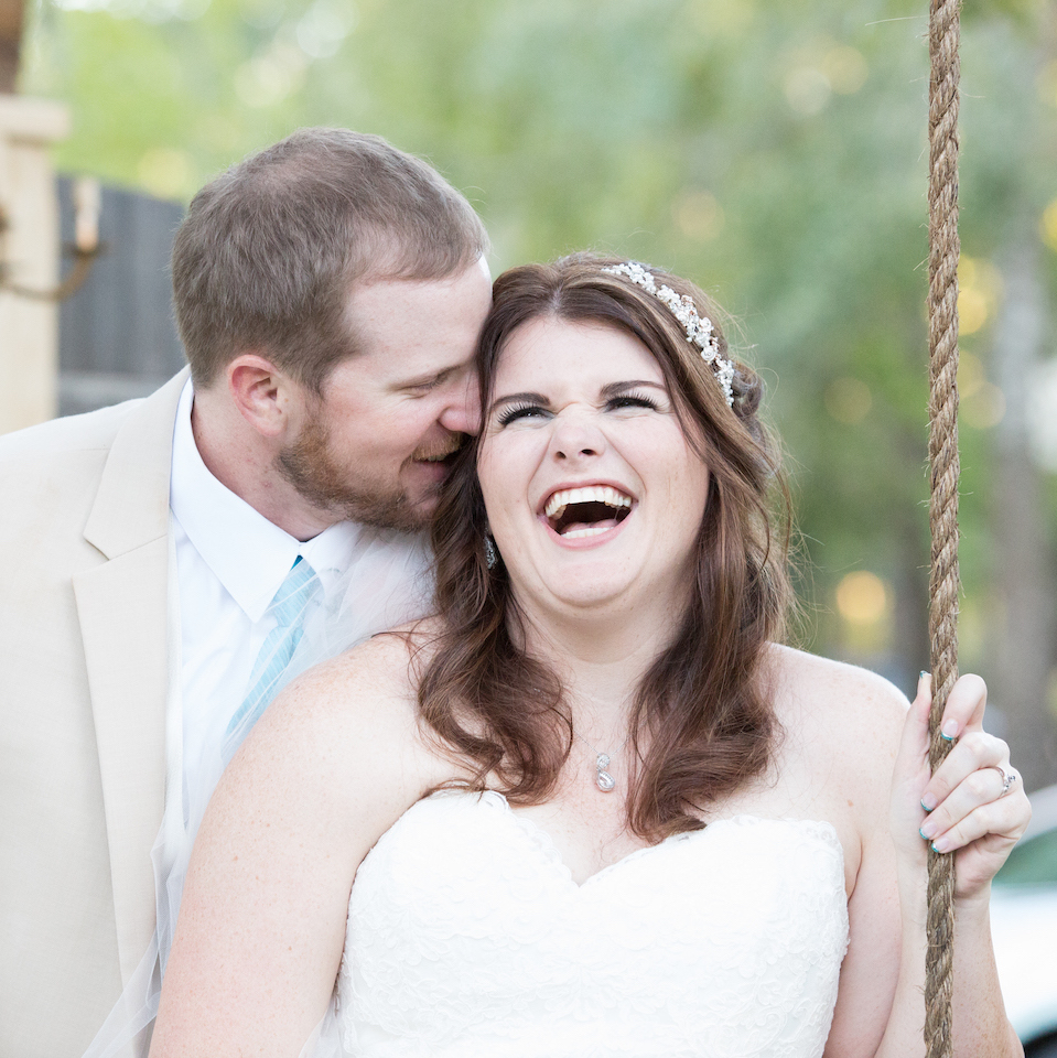 Wedding Photography - Wedding Couple Flirting around swing