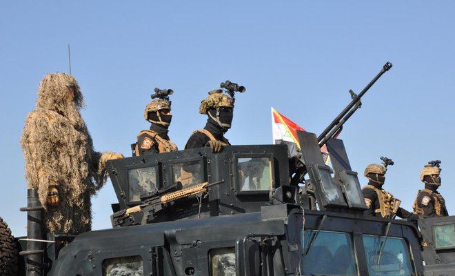 Iraqi federal police members were seen during an Iraqi military parade in Baghdad's fortified Green Zone, Iraq/REUTERS