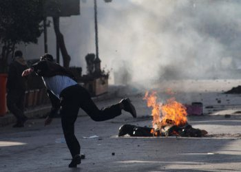 A Kurdish protester throws stone during a rally against the kurdistan Regional Government in Sulaimaniyah,Iraq/REUTERS