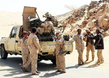 Yemeni tribesmen from the popular Resistance Committees. loyal to Yemen's Saudi-backed President,disembark from apickup truck carrying an anti-aircraft gun as they park on a desert road in Beihan , in the Shabwa Province/AFP