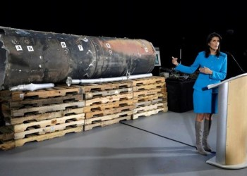"US Ambassador to the United Nations Nikki Haley briefs the media in front of remains of Iranian ""Qiam"" ballistic missile in Washington CREDIT: REUTERS/YURI GRIPAS"