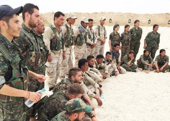 members of the Syrian Democrate Forces gather after a training sessin at a firing range in northern ,Syria/ AP