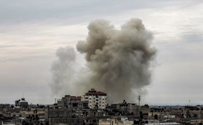 A view from the western Gaza strip border town of Rafah shows a smoke plume rising on the Egyptian side of the border following an explosion. Egypt closed its border with the Gaza Strip after Cairo launched a major operation against jihadists in the neighboring Sinai Peninsula. (AFP)