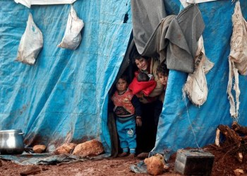 Displaced Syrian children look out from their tents at Kelbit refugee camp, near the Syrian-Turkish border, in Idlib province, Syria January 17, 2018. REUTERS/Osman Orsal