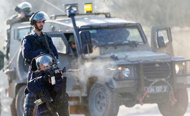 Israeli border policeman fires rubber coated bullets at Palestinians in the West Bank City of Nablus, in this file photo taken on Dec. 8, 2017. (AP)