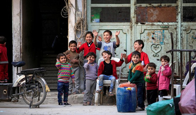 Children react during a media tour in Douma near Damascus, Syria April 23, 2018. (REUTERS)