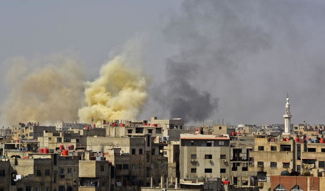 Photo showing the Yarmuk Palestinian refugee camp being pounded by Assad forces, southern Damascus, April 27, 2018. (AFP)