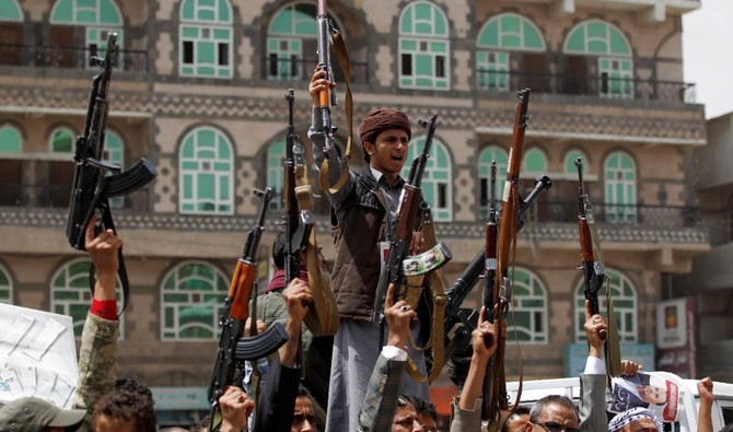 Supporters of Yemen's Houthi militia attend a rally in Sanaa on April 26, 2018 against the killing of their political chief Saleh al-Sammad. (AFP)