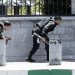 Members of Iranian forces take cover during an attack on the Iranian parliament in central Tehran, Iran, June 7, 2017. (Reuters)